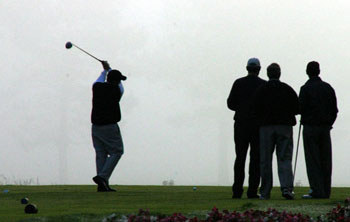 Four golfers tee off for a tournament at Beckett Ridge Golf Club